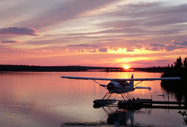 View of Float Plane at the Dock at Misaw Lake Lodge at Sunset